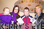 PRIZE: Shean Halpin (centre) picks up his prize for the Angel Art competition from Gretta Murphy of the Irish Wheelchair Association (right) pictured here with Shean's mother Sharon and sister Kelly.