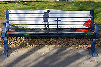 Pictured: One of the benches by Swansea Bay, Wales, UK. Sunday 28 October 2018 <br /> Re: Poppies have been painted on benches near the Cenotaph, to commemorate 100 years from the end of the second World War in 1918, Swansea, Wales, UK.