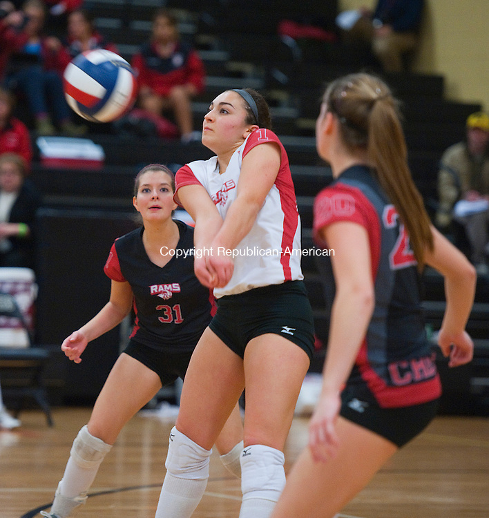 TRUMBULL- 111413JS07- Cheshire's Maria Buzzelli (1) returns a serve during their Class LL state tournament semifinal game against Fairfield Ludlowe Thursday at Trumbull High School. <br /> Jim Shannon Republican-American