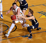 BROOKING, SD - NOVEMBER 21:  Ellie Thompson #45 from South Dakota State scoops up the loose ball against Madison Cable #22 from Notre  Dame in the first half of their game Saturday afternoon at Frost Arena in Brookings. (Photo by Dave Eggen/Inertia)