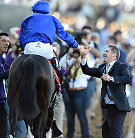 DEL MAR, CA - NOVEMBER 04: Mickael Barzalona, aboard Talismanic #1 is congratulate after winning the Longines Breeders' Cup Turf race on Day 2 of the 2017 Breeders' Cup World Championships at Del Mar Racing Club on November 4, 2017 in Del Mar, California. (Photo by John Durr/Eclipse Sportswire/Breeders Cup)