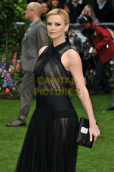 Charlize Theron.'Snow White And The Huntsman' World film premiere, Empire Cinema, London, England..May 14th, 2012.half length black sheer dress clutch bag see through thru.CAP/BF.©Bob Fidgeon/Capital Pictures.
