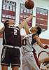 Rianna Cedeno #10 of Glen Cove, right, and Ashleigh Sheerin #2 of North Shore battle for a rebound during a varsity girls' basketball game at Glen Cove High School on Friday, Dec. 18, 2015. North Shore won by a score of 64-53.