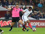 Christophe Berra of Scotland tackles Raheem Sterling of England during the FIFA World Cup Qualifying Group F match at Wembley Stadium, London. Picture date: November 11th, 2016. Pic David Klein/Sportimage