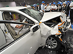 """July 21st, 2011, Susonosi, Japan - A Toyota Crown is badly damaged after a head-on collision with a Toyota VITZ at the speed of 55km/h (about 34 miles/h) in a demonstration at Toyotas Higashi-Fuji Technical Center on the foot of Mt. Fuji, some 92km (about 57 miles) southwest of Tokyo, on Thursday, July 21, 2011. Toyota showed to reporters technologies aimed at increasing safety for pedestrians and elderly drivers, as part of its initiatives to eliminate traffic casualties. The technologies include a Pre-Collision System with collision-avoidance assist, glare-preventing adaptive driving beams and a pop-up hood for lessening pedestrian injury. In the PCS, Toyota uses cameras and a super sensitive radar called """"millimeter-wave,"""" both installed in the front of the vehicle, to detect possible crashes such as a pedestrian crossing the road. Then the vehicle calculates how braking and steering must be applied to avoid a crash. (Photo by Natsuki Sakai/AFLO) [3615] -mis-"""