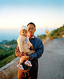INDIA, West Bengal, portrait of father holding his daughter, Kurseong