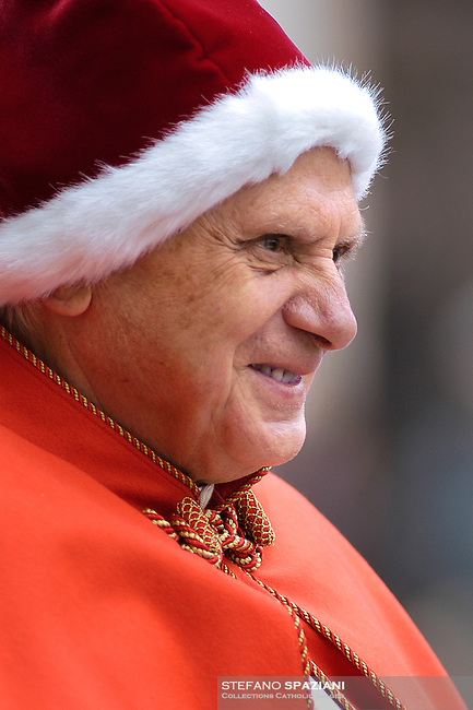 Pope Benedict XVI, sporting a fur-trimmed hat in the rich red color of a Santa hat , arrives in St. Peter's Square at the Vatican, for his weekly general audience. The red hat with white fur trimming is known in Italian as the 'camauro.' It was popular among pontiffs in the 17th century. More recently, it was used by Pope John XXIII, who was also buried with it in 1963...December 21, 2005 .... December. 25, 2007.. .