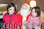 HI, SANTA: Katelyn and Victoria Nolan from Killarney met Santa Claus when he dropped into Milltown Community Hall on Sunday last.