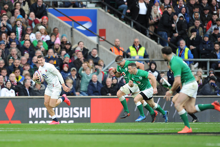 Jonny May of England accelerates past CJ Stander and John Cooney of Ireland during the Guinness Six Nations match between England and Ireland at Twickenham Stadium on Sunday 23rd February 2020 (Photo by Rob Munro/Stewart Communications)