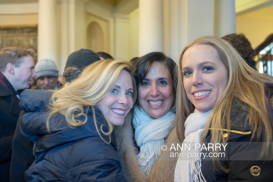 Mineola, New York, USA. January 1, 2018. L-R, Hempstead Town Supervisor LAURA GILLEN, Hempstead Town Clerk SYLVIA CABANA, and SUE MOLLER, who ran for Town of Hempstead Town Council, get together inside Theodore Roosevelt Executive & Legislative Building, after Historic swearing-In of LAURA CURRAN as Nassau County Executive, the first female County Executive, is held outdoor that building. Temperature was a freezing 14 ℉ Fahrenheit / -10 ℃  Celsius.