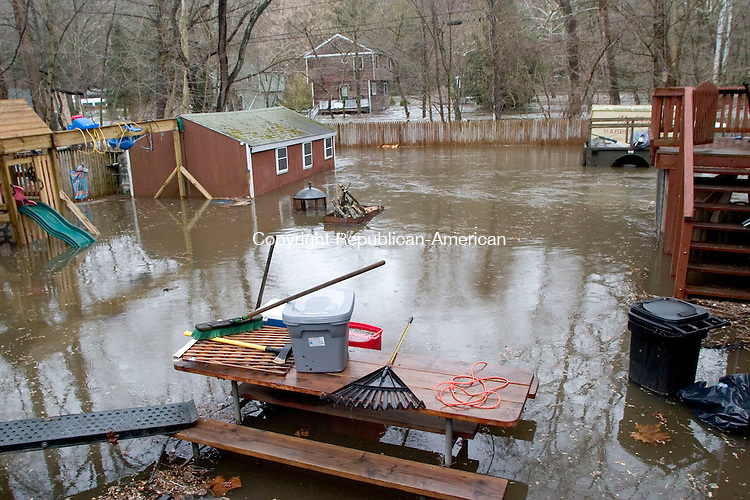 OXFORD, CT- 16 APRIL 07- 041607JT02- <br /> The overflowing Housatonic River made its way under houses, into basements, and over backyards such as this one along Route 34 in Oxford on Monday.<br /> Josalee Thrift Republican-American