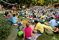 Cultural event photography of the 2012 Charlotte Shakespeare Festival, which took place on The Green in Uptown Charlotte from May 31 to June 17, 2012. Charlotte Shakespeare is a professional theatre company offering intimate performances of traditional and modern classics. The company was formed in 2005 by Elise Wilkinson and Joe Copley under the name Collaborative Arts Theatre. In 2012 the name changed to Charlotte Shakespeare. Wide angle photo provides an overall scene setter to show the performance as well as The Green's public space.