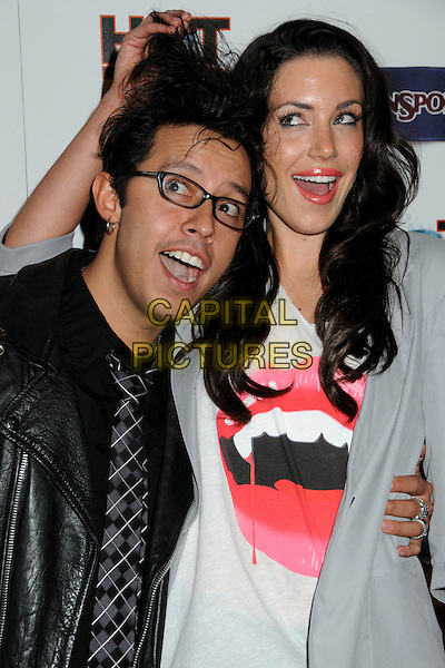 "EFREN RAMIREZ & DOROTHY VALENTINE.""Hot Time Time Machine"" World Premiere Party held at the Cabana Club, Hollywood, California, USA..March 17th, 2010.half length leather jacket grey gray white pink black glasses messy hair lips mouth plaid tartan tie mouth open funny .CAP/ADM/BP.©Byron Purvis/AdMedia/Capital Pictures."