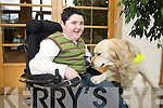 Christian Mayse who suffers from muscular dystrophy with his dog Adam  which he got from dogs for disabled to help Christian in everyday tasks.