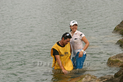 February 18, 2006; Kahuku, HI - Joo Mi Kim (right) and her caddie are all wet after jumping in the water at the 18th hole after winning the LPGA SBS Open at Turtle Bay Resort...Mandatory photo credit: Darrell Miho.© Darrell Miho