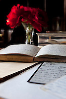 Old family diaries lie open on the bureau in the living room