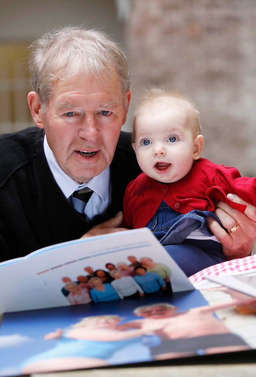 No Repro Fee..Solidarity between Generations?..Pictured at the launch of the 2012 Pfizer Health Index is legendary GAA and sports broadcaster, Mícheál Ó Muircheartaigh with Edie Kennedy, six months old..The Pfizer Health Index is being launched to coincide with European Year for Active Ageing and Solidarity between Generations..Pic: Robbie Reynolds/CPR..