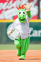 "Charlotte Knights mascot ""Homer the Dragon"" waves to fans as he runs the bases at Knights Stadium August 8, 2010, in Fort Mill, South Carolina.  Photo by Brian Westerholt / Four Seam Images"