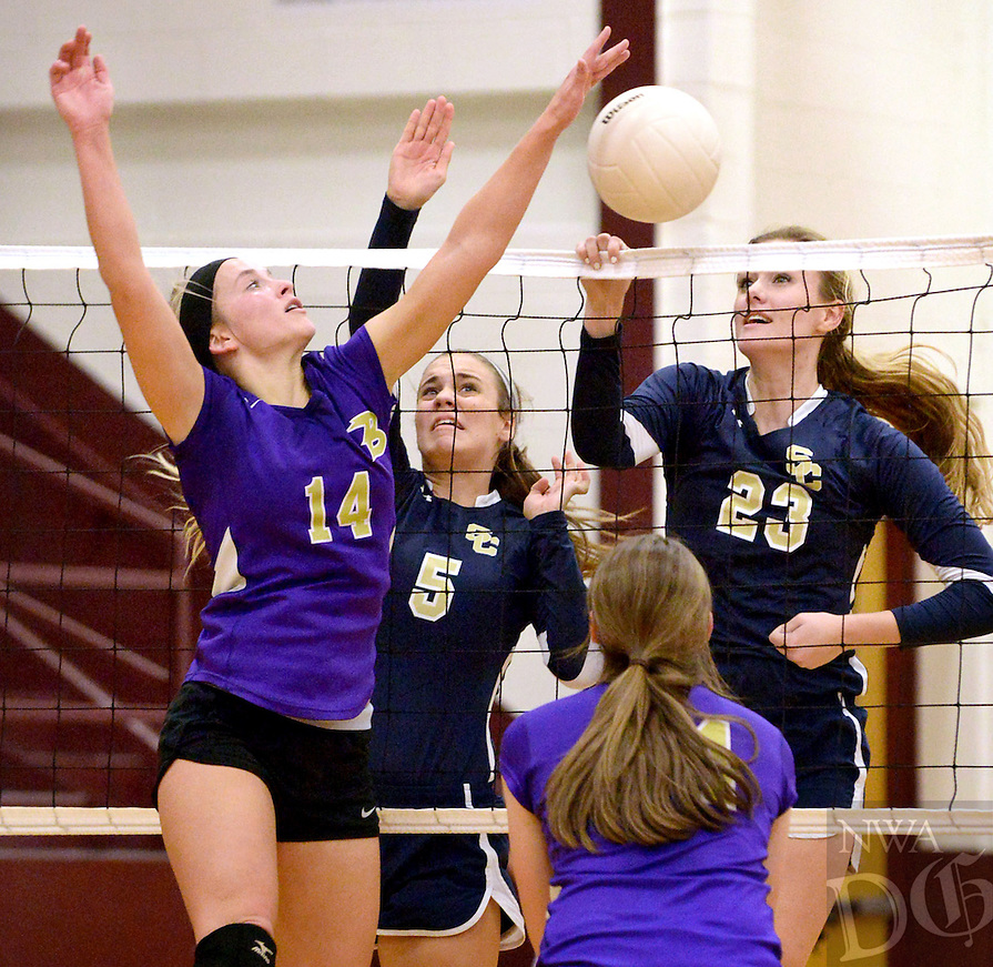 STAFF PHOTO BEN GOFF  @NWABenGoff -- 10/23/14 Aleskie Smith of Berryville, from left, goes up against Anna Gookin and Tori Richards of Shiloh Christian to tap the ball over the net during the 4th set of the championship match in the 4A-1 Conference volleyball tournament Gentry High School on Thursday October 23, 2014.