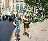 Visitors to Herald Square in New York receive free bottles of Nestea brand iced tea as well as view a tiny house that Nestea has brought on Wednesday, May 17, 2017. The 200 square foot tiny house symbolizes Nestea's less is more philosophy promoting simpler recipes in their bottled iced tea.  (© Richard B. Levine)