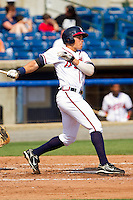 Hilton Richardson #15 of the Rome Braves follows through on his swing against the Hagerstown Suns at State Mutual Stadium on May 2, 2011 in Rome, Georgia.   Photo by Brian Westerholt / Four Seam Images