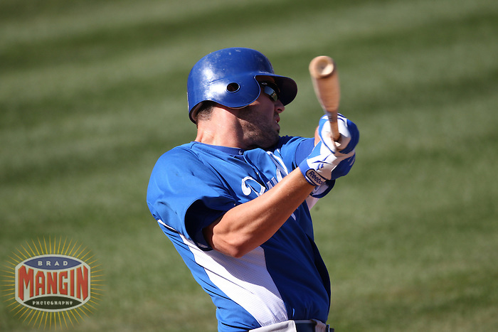 TEMPE, AZ - MARCH 10:  Mike Moustakas of the Kansas City Royals bats during the spring training game between the Kansas City Royals and the Los Angeles Angels on March 10, 2011 at Tempe Diablo Stadium in Tempe, Arizona. Photo by Brad Mangin
