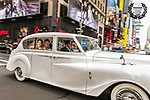 After their regal ceremony in New York's iconic St. Patrick's Cathedral, Kimberly and Christian savoured the joyful moment with a ride in their Rolls through Times Square.