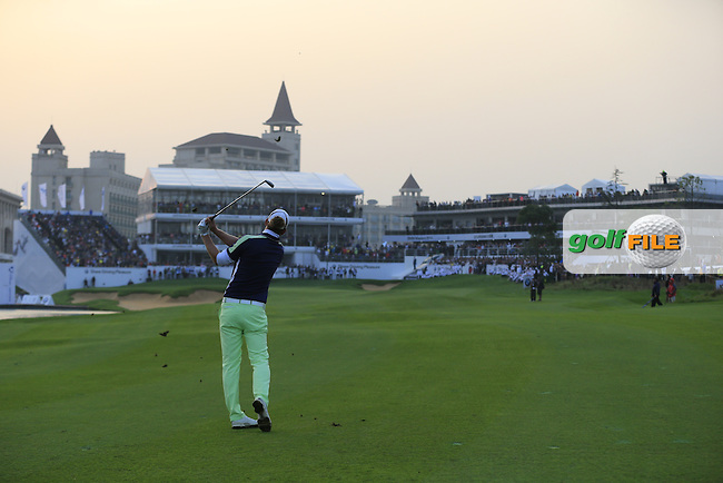 Marcel Siem (GER) plays his 2nd shot on the the playoff hole during Sunday's Final Round of the 2014 BMW Masters held at Lake Malaren, Shanghai, China. 2nd November 2014.<br /> Picture: Eoin Clarke www.golffile.ie