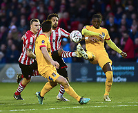 Lincoln City's Bruno Andrade vies for possession with Northampton Town's David Buchanan, left, and Hakeem Odoffin<br /> <br /> Photographer Andrew Vaughan/CameraSport<br /> <br /> Emirates FA Cup First Round - Lincoln City v Northampton Town - Saturday 10th November 2018 - Sincil Bank - Lincoln<br />  <br /> World Copyright © 2018 CameraSport. All rights reserved. 43 Linden Ave. Countesthorpe. Leicester. England. LE8 5PG - Tel: +44 (0) 116 277 4147 - admin@camerasport.com - www.camerasport.com