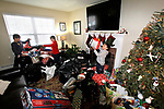 CHESHIRE, CT - 30 DECEMBER 2017 - 123017JW10.jpg -- At their home, brothers Shepard Maher, Becket Maher, and Alden Maher open their replacement gifts donated to them after the story of how theirs were stolen along with the family car on Christams Day was posted to social media sites by the Cheshire Police Benevolent Association. Jonathan Wilcox Republican-American