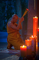 Monastery near the Bayon Temple, Angkor area, Siem reap, Cambodia A buddhist monk worshipping during twilight