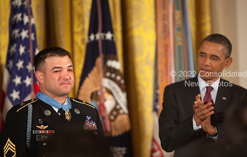 U.S. President Barack Obama claps for Sergeant First Class Leroy Arthur Petry, U.S. Army, after giving him the Medal of Honor for conspicuous gallantry and intrepidity at the risk of his life above and beyond the call of duty in the East Room of the White House in Washington D.C., July 12, 2011.  Sergeant Petry is receiving the medal for his courageous actions during combat operations against an armed enemy in Paktya, Afghanistan in May, 2008 and is the second living, active duty service member to be awarded the Medal of Honor for actions in Iraq or Afghanistan. .Credit: Allison Shelley / Pool via CNP