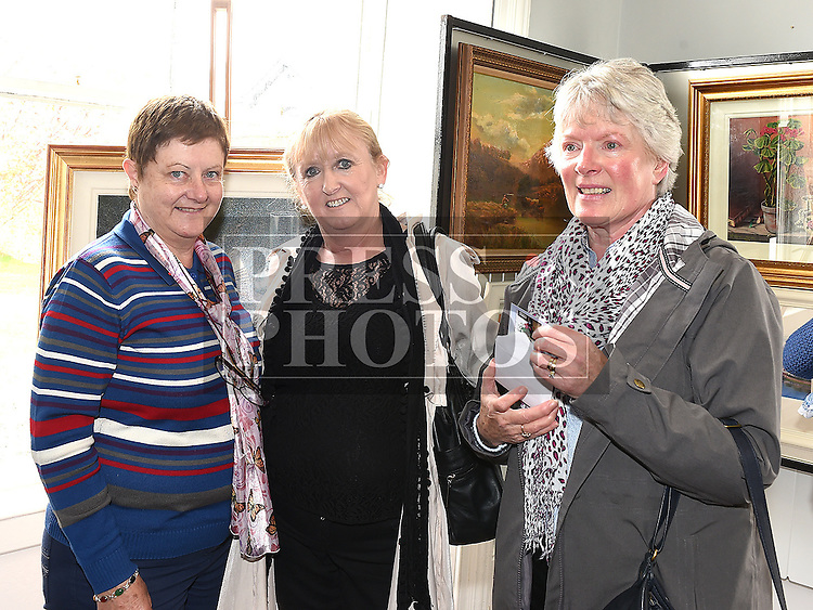 Anne Matthews, Rita Dunne and Meave Holly pictured at an exhibition by the late artist Dahamne Hocine in the Market House Dunleer.  Photo:Colin Bell/pressphotos.ie