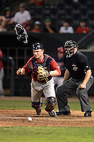 Oklahoma City RedHawks catcher Max Stassi (10) retrieves a ball in the dirt in front of umpire Spencer Flynn during a game against the Memphis Redbirds on May 23, 2014 at AutoZone Park in Memphis, Tennessee.  Oklahoma City defeated Memphis 12-10.  (Mike Janes/Four Seam Images)