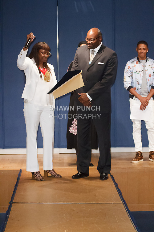 Sterling Roberson (right) - UFT Vice President CTE receives a Citation from the Brooklyn Borough President's Office, during the Teachers Rock The Runway fashion show presented by the United Federation of Teachers, at 52 Broadway in New York City, on May 31st 2018.