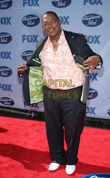 "RANDY JACKSON.""American Idol"" Season 4 Finale held at The Kodak Theatre..May 25th, 2005.Photo Credit: Jacqui Wong/AdMedia.full length opening jacket gesture pinstripe pink shirt.www.capitalpictures.com.sales@capitalpictures.com.© Capital Pictures."