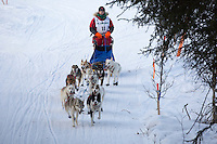 Joan Klejka runs on the inbound trail towards the finish line of the 2016 Junior Iditarod in Willow, Alaska, AK  February 28, 2016