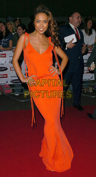 MYLEENE KLASS.Pride of Britain Awards 2005, London.October 10th, 2005.Ref: CAN.full length red dress hands on hips.www.capitalpictures.com.sales@capitalpictures.com.©Capital Pictures