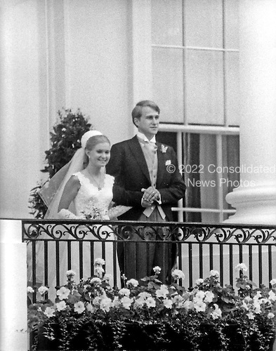 "Washington, DC - June 12, 1971 -- Tricia Nixon Cox, left, and her husband, Edward Cox, right, pose on the balcony of the South Portico of the White House in Washington, D.C. on Saturday, June 12, 1971 following their marriage in the Rose Garden.  More than 400 guests attended the dazzling affair..Credit: Benjamin E. ""Gene"" Forte - CNP"