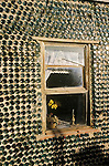 Window, The Bottle House, built in 1905 by 76 year-old Tom Kelly from 30,000 bottles in Rholite, Nev.