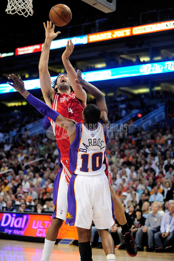 Mar. 22, 2008; Phoenix, AZ, USA; Houston Rockets forward (4) Luis Scola shoots under pressure from Phoenix Suns guard (10) Leandro Barbosa at the US Airways Center. Mandatory Credit: Mark J. Rebilas