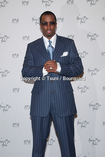 "Puffy Comb in the pressroom at the 29th Annual American Music Awards  at the Shrine Auditorium in Los Angeles  Wednesday, Jan. 9, 2002.            -            Sean""PDiddy""Combs10A.jpg"