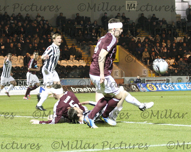 Darren Barr brings down Lee Mair to concede the penalty in the St Mirren v Heart of Midlothian Clydesdale Bank Scottish Premier League match played at St Mirren Park, Paisley on 27.2.13.