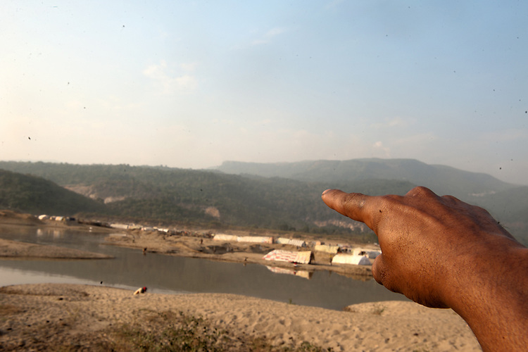 Local villagers working for companies to collect rolling stones from the River Dholai often become victims of border killings by the Indian Border Security Force (BSF). Elias Mia, a border victim points out the place where he was shot by BSF.