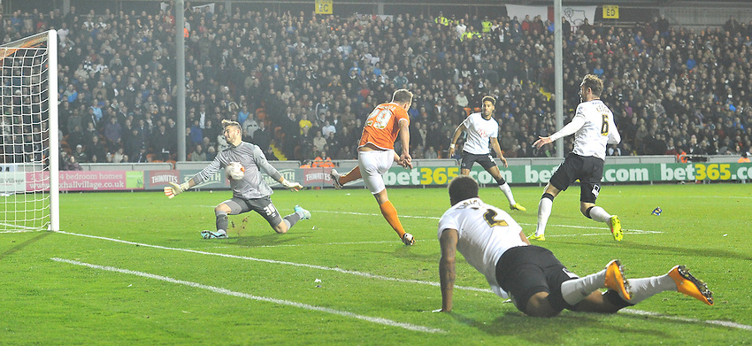 Blackpool's Anthony McMahon's shot is saved by the Derby County keeper<br /> <br /> Photographer Dave Howarth/CameraSport<br /> <br /> Football - The Football League Sky Bet Championship - Blackpool v Derby County - Tuesday 21st October 2014 - Bloomfield Road - Blackpool<br /> <br /> &copy; CameraSport - 43 Linden Ave. Countesthorpe. Leicester. England. LE8 5PG - Tel: +44 (0) 116 277 4147 - admin@camerasport.com - www.camerasport.com