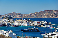 The famous windmills and the port of Mykonos, Greece