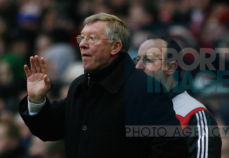 Sir Alex Ferguson Manchester united manager with Liverpool manager Rafael Benitez on his shoulder