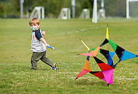 NWA Democrat-Gazette/BEN GOFF @NWABENGOFF<br /> Brecken Mostyn, 1, of Rogers tries to get his kite in the air on Sunday Sept. 13, 2015 while flying with his family at Memorial Park in Bentonville.