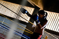 Geraldin Hamann, a young Colombian boxer, practices shadowboxing while training in the boxing gym in Cali, Colombia, 26 June 2013. During the recent years, Kina Malpartida, a Peruvian female professional boxer, has won the World Championship title several times and so she has become a sporting idol and an inspiration for a generation of young girls throughout Latin America. Working out hard in poorly equipped gyms, they dream of becoming a boxing star. The Cauca Valley and the Caribbean coast are believed to be a home of the most talented female boxers in Colombia.
