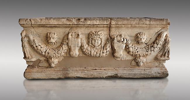 Roman relief sculpted garland sarcophagus, 3rd century AD. Adana Archaeology Museum, Turkey. Against a grey background